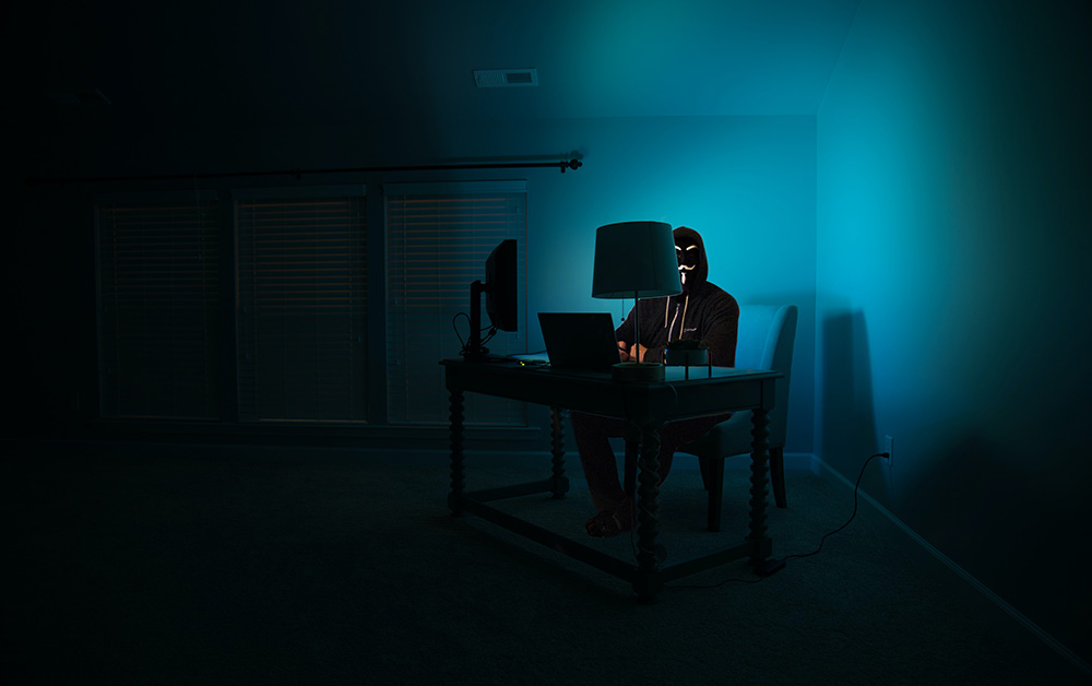 Hacker sitting at his desk
