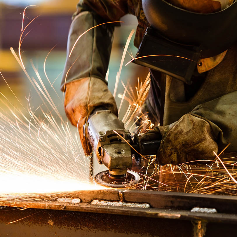 Sparks fly as a worker uses machinery