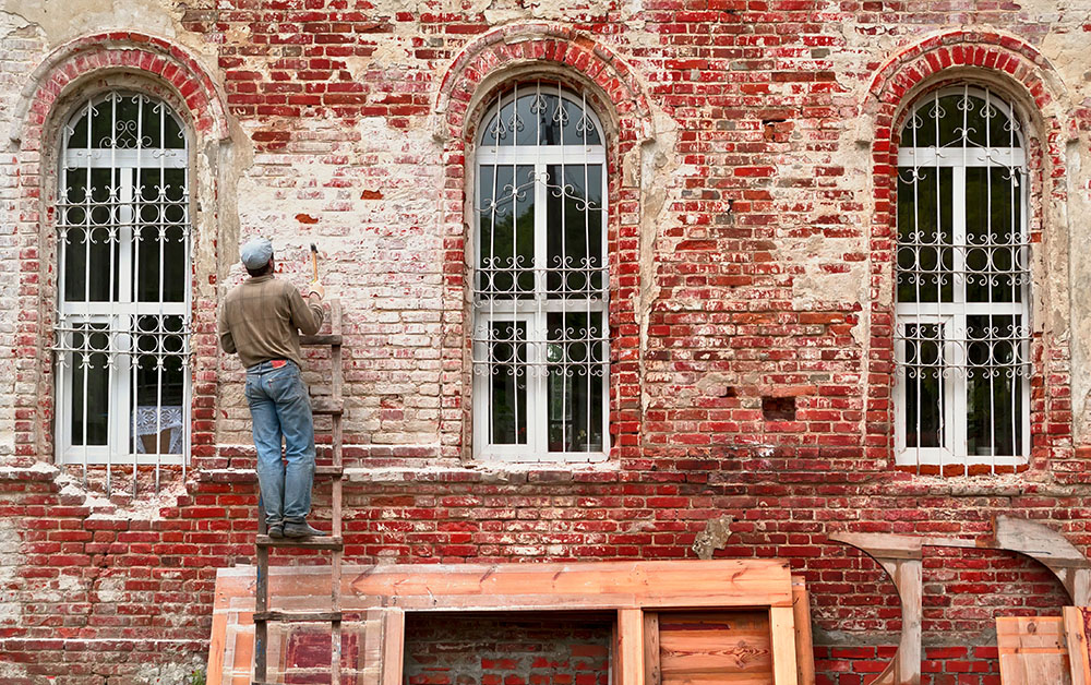 Construction worker works on a historic building